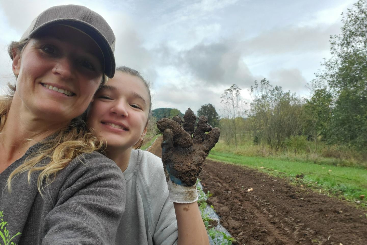 Planting in the rain makes for muddy hands