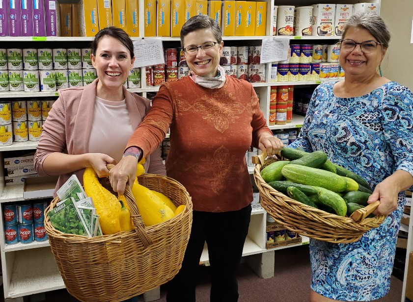 On Tuesday morning, August 4, 2020, Genesis- Thomas County Board Member Ann Miner accepted two heaping baskets of produce from Thomas County Coalition Coordinator Christina Beringer (left) and Copeland Garden Co-Coordinator Maureen Ostmeyer (right). The donated produce will be given to families in need on Wednesday this week.