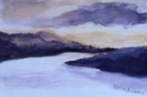 Loch with Mountains on size its a sunset dramatic purple sky