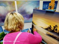 the artist with work in progress.jpg