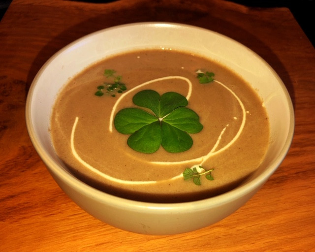 Wild mushroom soup made with foraged wild mushrooms - garnished with wood sorrel and hairy bittercress