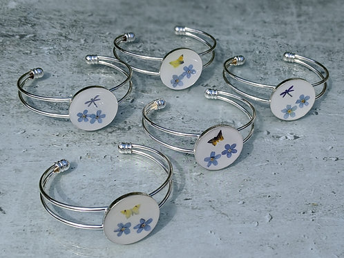 Real pressed flower resin silver tone cuff bracelet.