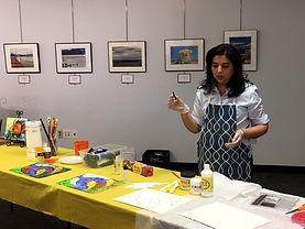 Seema Teaching holding charcoal.jpg