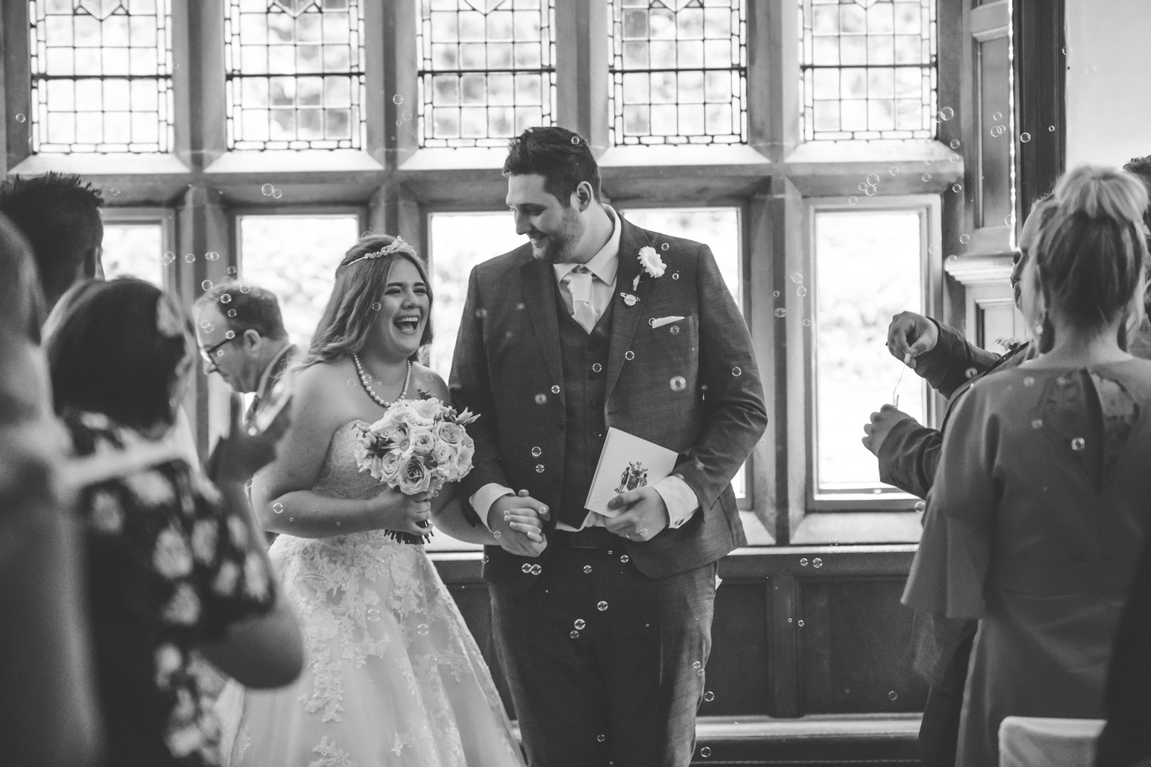 Wedding bubbles couple walking down isle