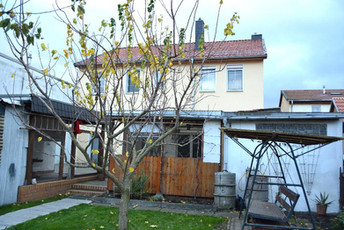 06-Nebenhaus Gartenseite.jpg