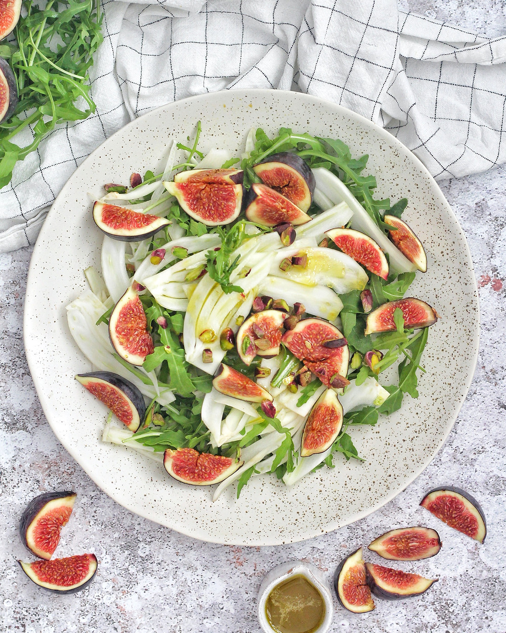 Easy salad recipe using fresh figs, fennel, and pistachios