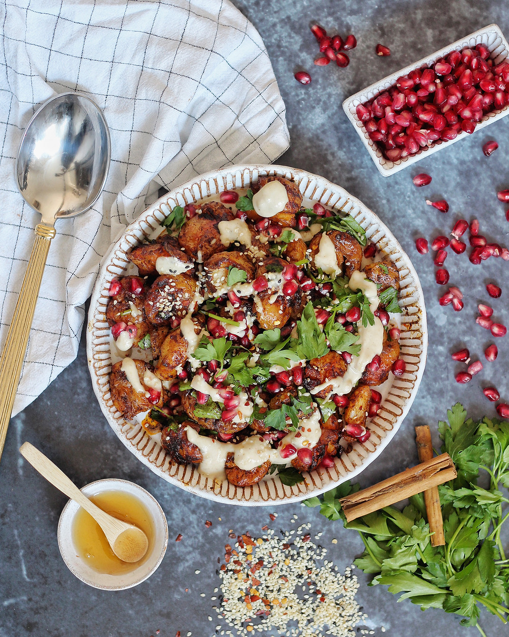 Delicious smashed potatoes with hot honey and tahini