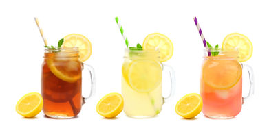 Three mason jar glasses of summer iced t