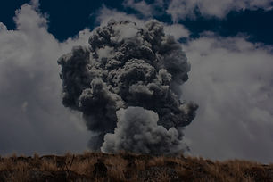 black smoke burst in brown open field at daytime_edited.jpg