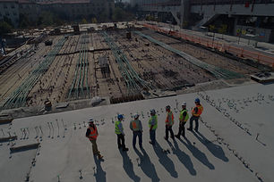 seven construction workers standing on white field_edited.jpg