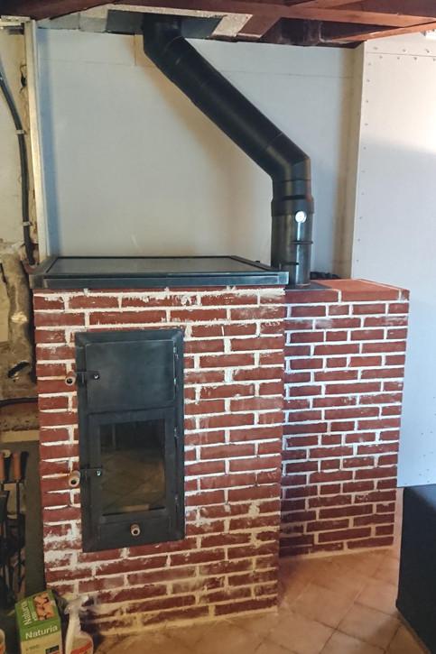Un B14 V4 avec mur de chauffe et habillage en briques foraines