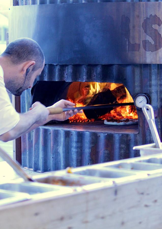 Wood fire pizza making by DOC at the Melbourne Salami Festa, Northcote, Victoria, Australia