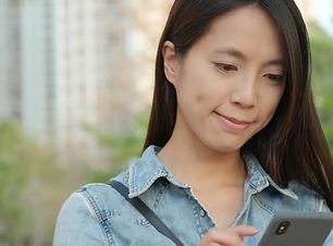 asian woman holding phone 1.jpg