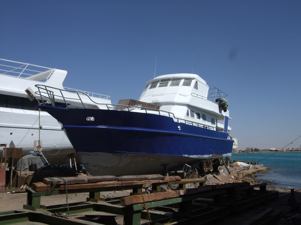 Dive Runner coming out of the water and being blocked up. Once in place the sanding begins