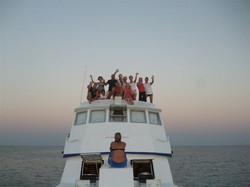 group on top of boat