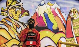 Shoe shne boy La Paz, Bolivia with mural