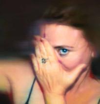 WOMAN COVERING AN EYE, 2005