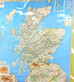Sticking stickers on our map of Scotland!