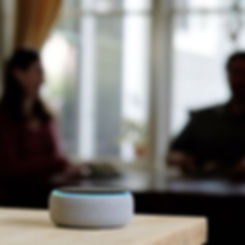 A woman in man listen to an Amazon Echo