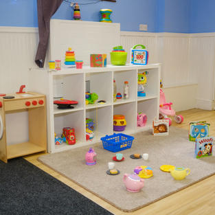 Carpet area to play on and lots of lovely toys