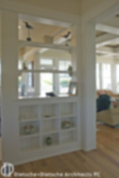 Built-in shelves divide space Dietsche + Dietsche