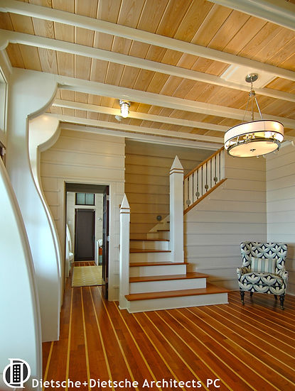 . Floor, walls, ceiling, and staircase use visible wood planking made from eco-friendly lumber.