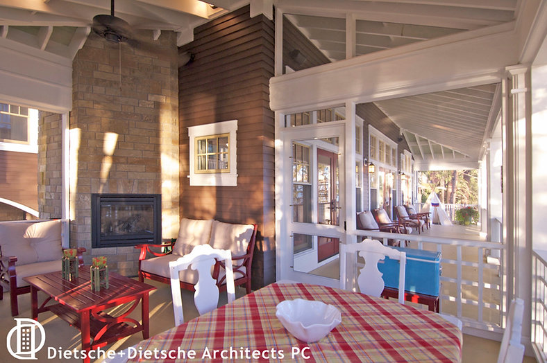 The second-level lakeside porch is an extension of the living room at Cottage on a Lake.