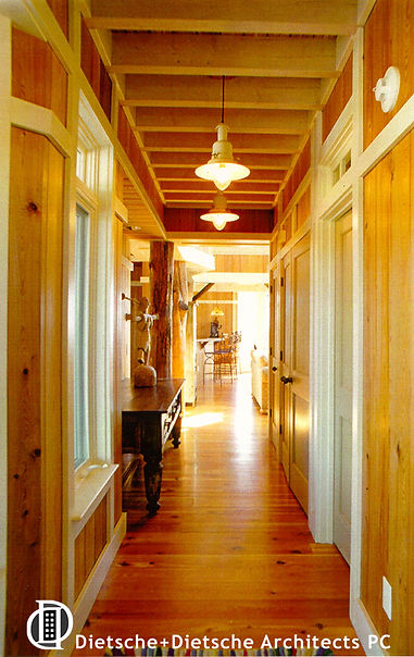 River recovered cypres and local hearn pine floors in Texas Cottage Dietsche + Dietsche Architects