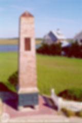 shingled obelisk is a purple martin house