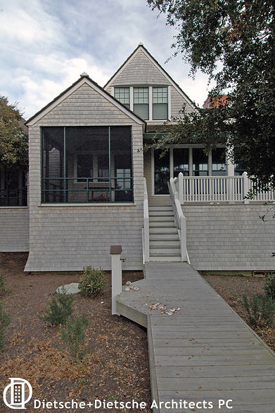 Traditional Shingle Style asymmetry creates variety and without sacrificing balance.