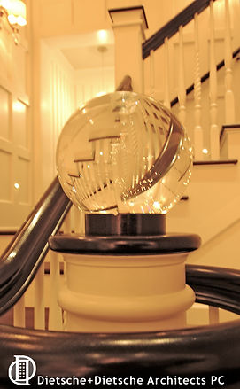 "Caribbean Dream, Dietsche + Dietsche Architects, North CarolinaA 14"" lighted crystal ball tops the newel post at the bottom of the central staircase."