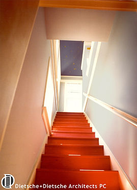 With fairy-tail whimsy, the bright red staircase ascends to a starry midnight sky.