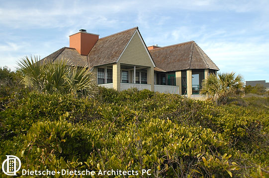 Established native landscaping suggests a cottage that has been in the family for generations.