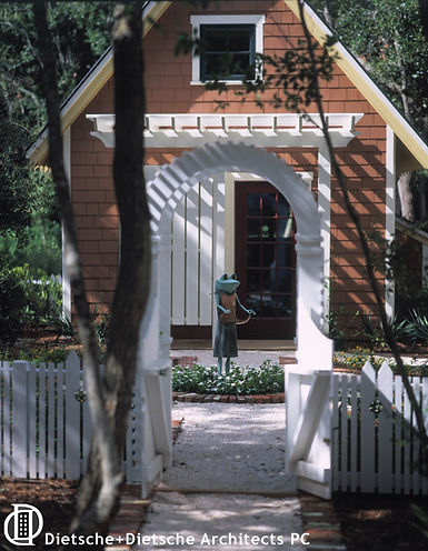 A romantic gated trellis frames the whimsical cottage garden.