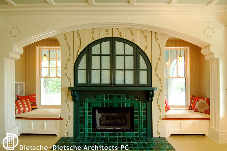 A spectacular mantle is framed by cozy window seats under an oversized proscenium arch.