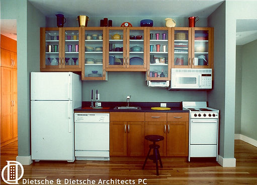 The efficient kitchen is tucked against a wall with playful precision and colorful utility.