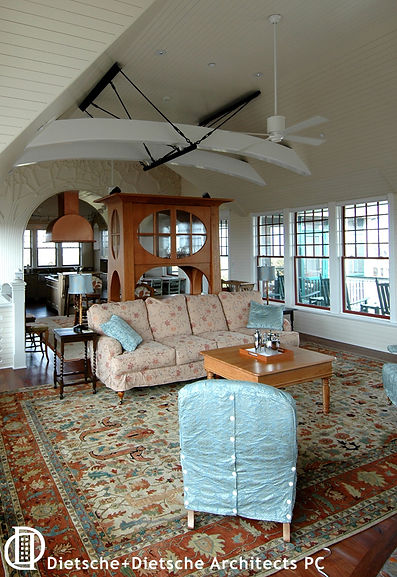 A modern truss supports the rafters across the main room allowing for airy spaciousness