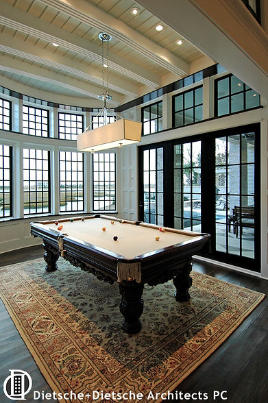 The porch-like billiard room transports an English gentleman's club esthetic to the tropical  seaside.