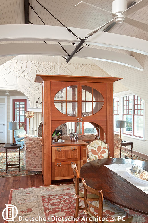 Art nouveau styling, oversized Victorian proportions, and built-in wetbar combine this contemporary hutch.