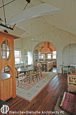 The limbs of two trees in the dining area frame the kitchen and a friendly breakfast nook.
