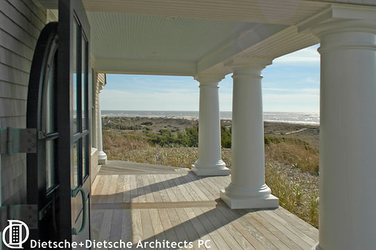 Whale Cottage porch columns frame the views that inspired this epic retreat.