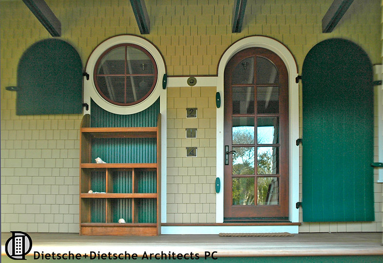 A circular window and round-topped functioning hurricane shutter create lasting memories.