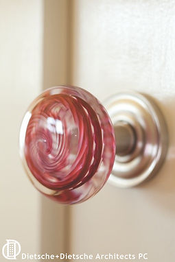 Custom made glass door knobs add color and a nod to the past
