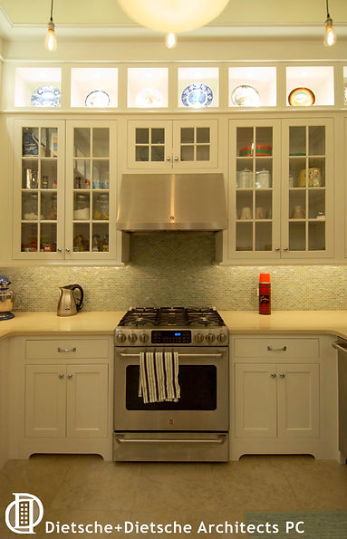 Assemble the provisions for an early morning fishing trip in this light infused kitchen with camp style storage.