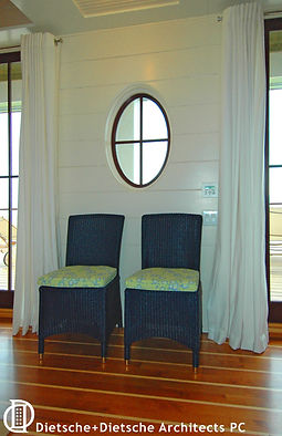 A romantic porthole creates nautical balance.