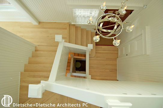 The turning staircase at Cottage on a Lake brings together the living spaces and bedrooms.