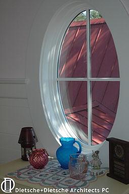 Oval window in fairytail cottage Dietsche + Dietsche Architects PC