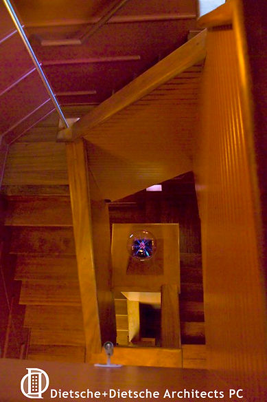 The stairway in Whale Cottage evokes secret passageways and the romance of coming above deck.