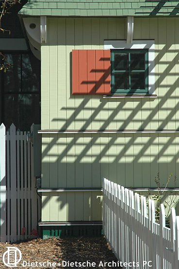 small window with working shutter in lattice shadow