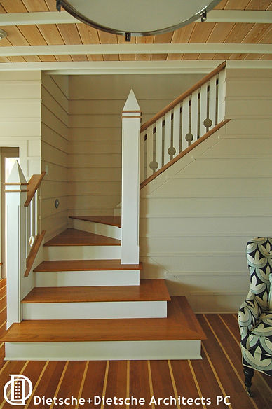 Floor, walls, ceiling, and staircase use visible wood planking made from eco-friendly lumber.